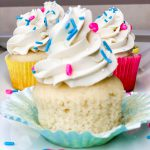 Vanilla cupcakes with vanilla frosting and sprinkles